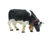 51015 Черно-белая пасущаяся корова